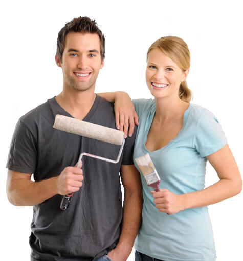 Couple with paint brush and roller ready to remodel home