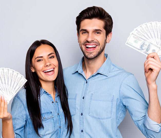 Man and women holding up thousands of dollars