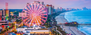 Myrtle Beach ferris wheel close up and buildings along the coast