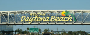 Welcome to Daytona Beach sign over highway into city